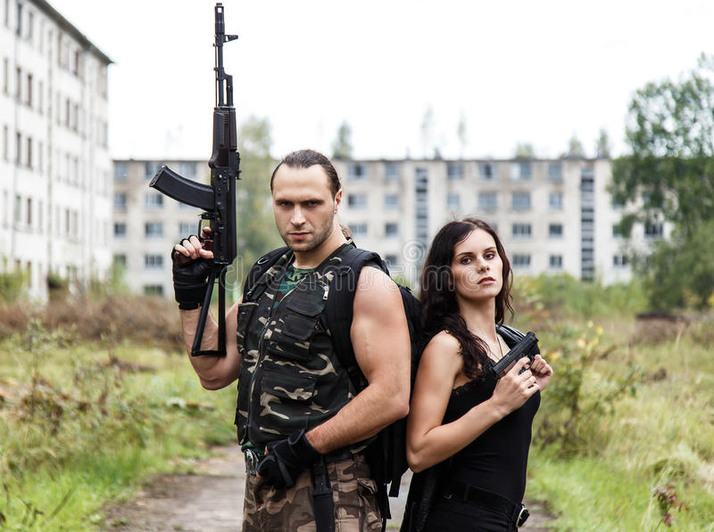 Guy with girl on a battlefield. War, conflict. Guy with girl on a battlefield royalty free stock photos