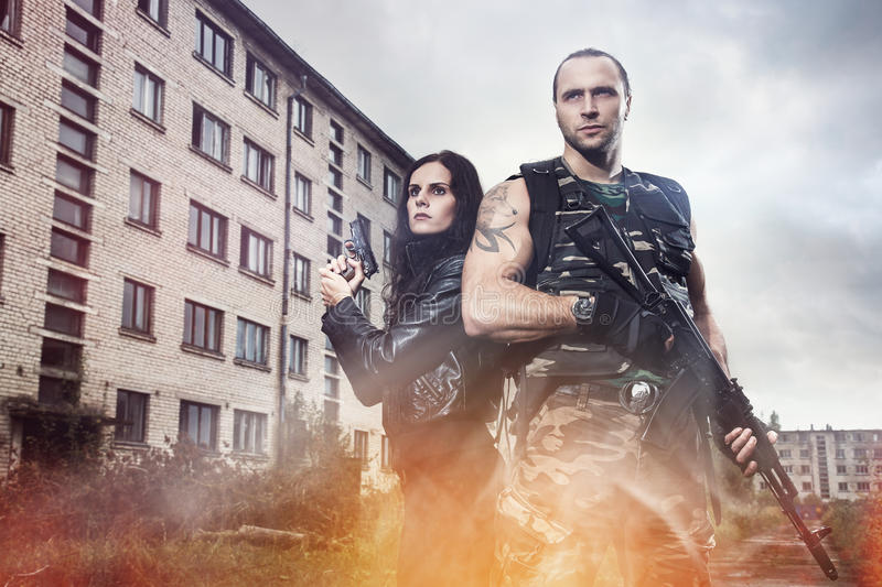 Guy with girl on a battlefield. War, conflict. Guy with girl on a battlefield royalty free stock photo