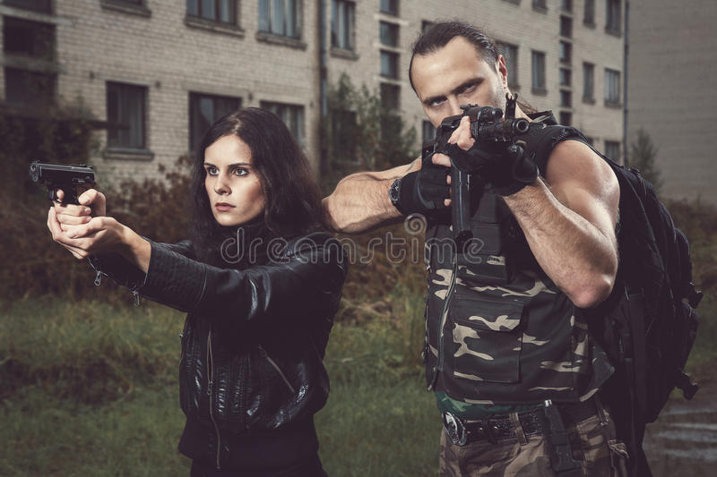 Guy with girl on a battlefield. War, conflict. Guy with girl on a battlefield stock images