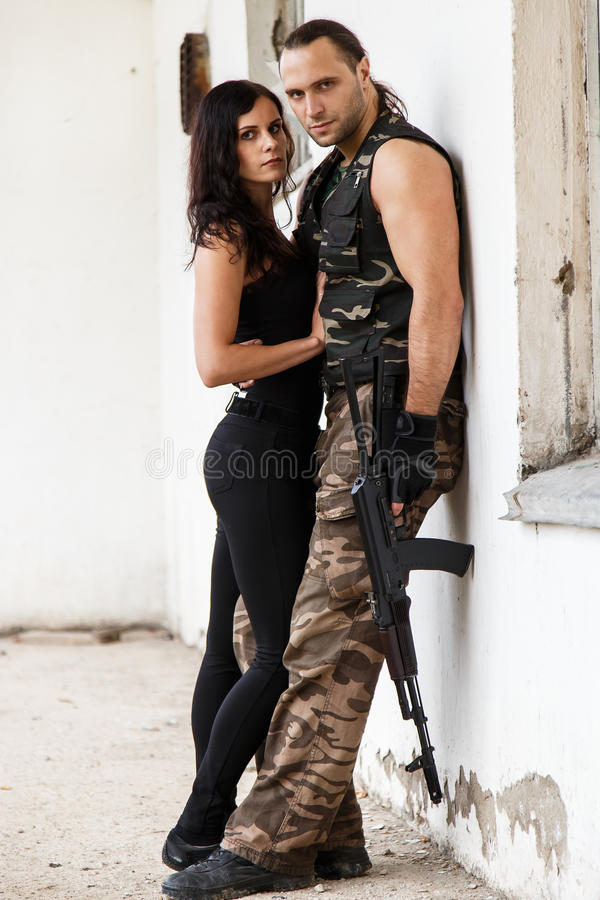 Guy with girl on a battlefield. War, conflict. Guy with girl on a battlefield royalty free stock image