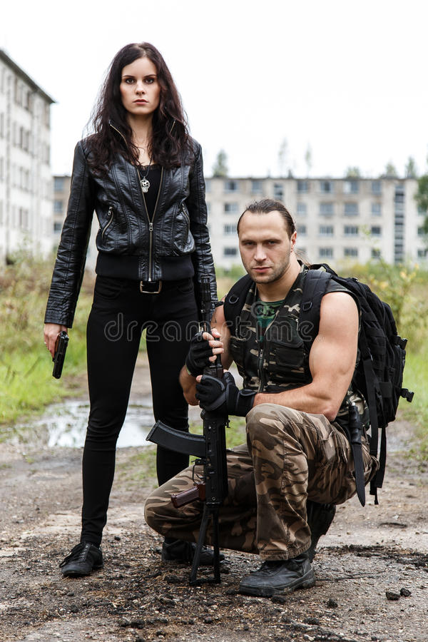 Guy with girl on a battlefield. War, conflict. Guy with girl on a battlefield royalty free stock images