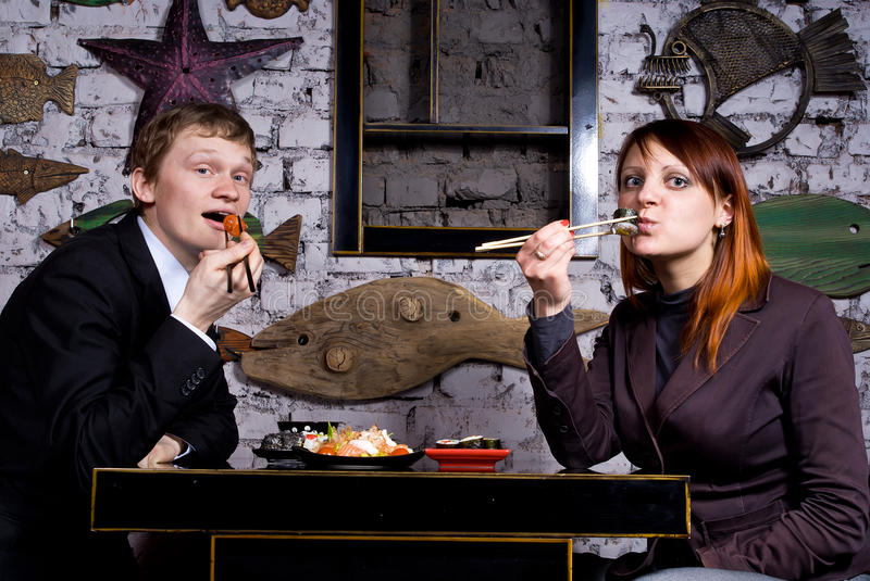 Download The Guy With The Girl Eat Sushi Stock Photo - Image: 24538198