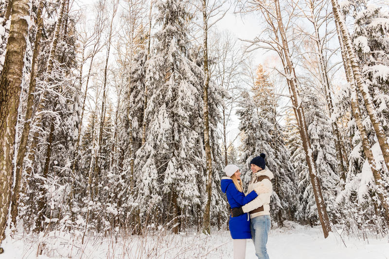 Download The Guy And The Girl Have A Rest In The Winter Woods. Stock Photo - Image: 83718150