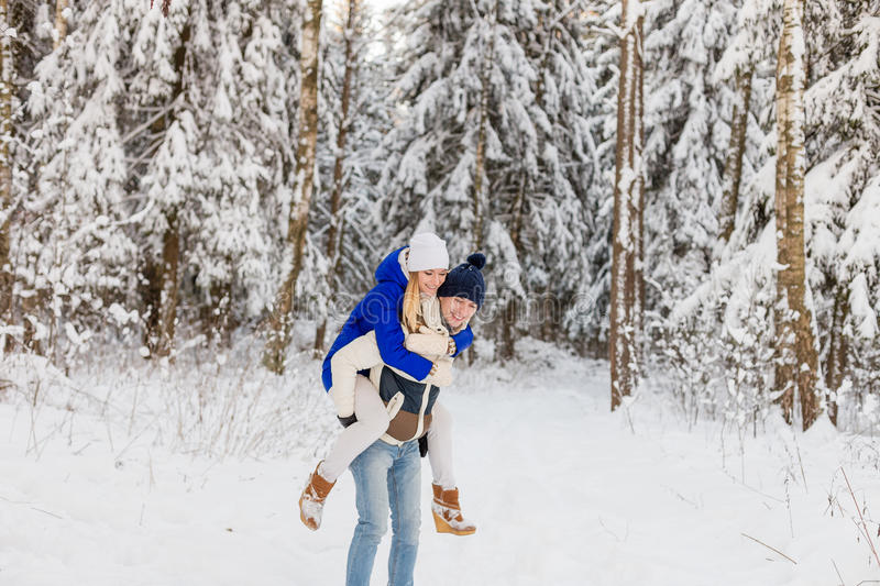 Download The Guy And The Girl Have A Rest In The Winter Woods. Stock Photo - Image: 83719579