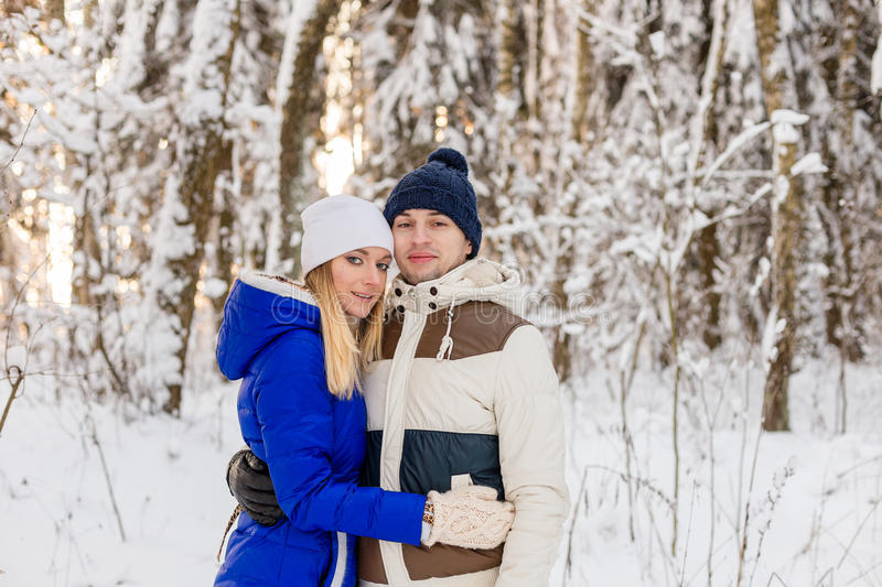 Download The Guy And The Girl Have A Rest In The Winter Woods. Stock Photo - Image: 83719728