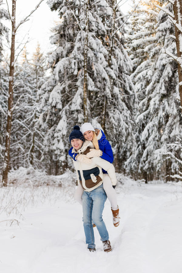 Download The Guy And The Girl Have A Rest In The Winter Woods. Stock Photo - Image: 83719744