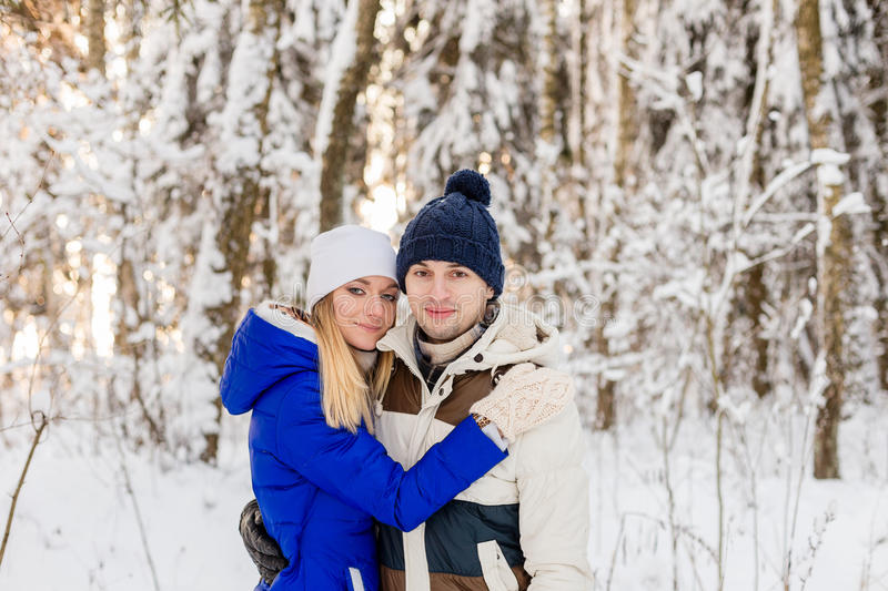 Download The Guy And The Girl Have A Rest In The Winter Woods. Stock Photo - Image: 83719832
