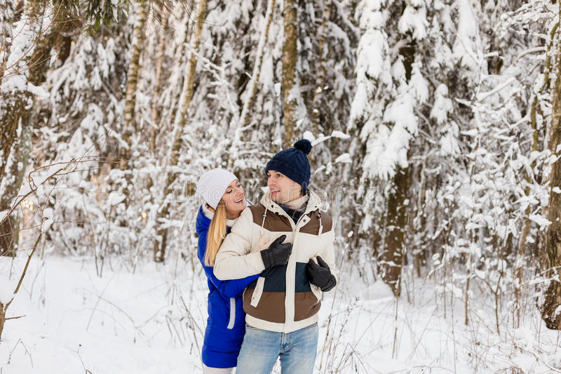 Download The Guy And The Girl Have A Rest In The Winter Woods. Stock Photo - Image: 83720069