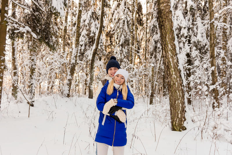 Download The Guy And The Girl Have A Rest In The Winter Woods. Stock Photo - Image: 83720082