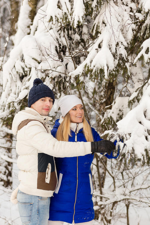 Download The Guy And The Girl Have A Rest In The Winter Woods. Stock Photo - Image: 83720096