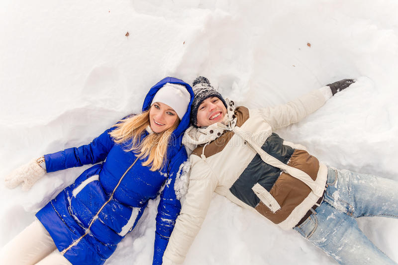 Download The Guy And The Girl Have A Rest In The Winter Woods. Stock Photo - Image of snow, smile: 83720532