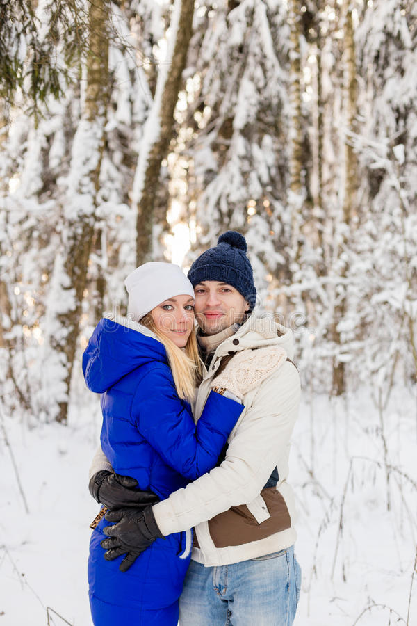 Download The Guy And The Girl Have A Rest In The Winter Woods. Stock Photo - Image: 83720809
