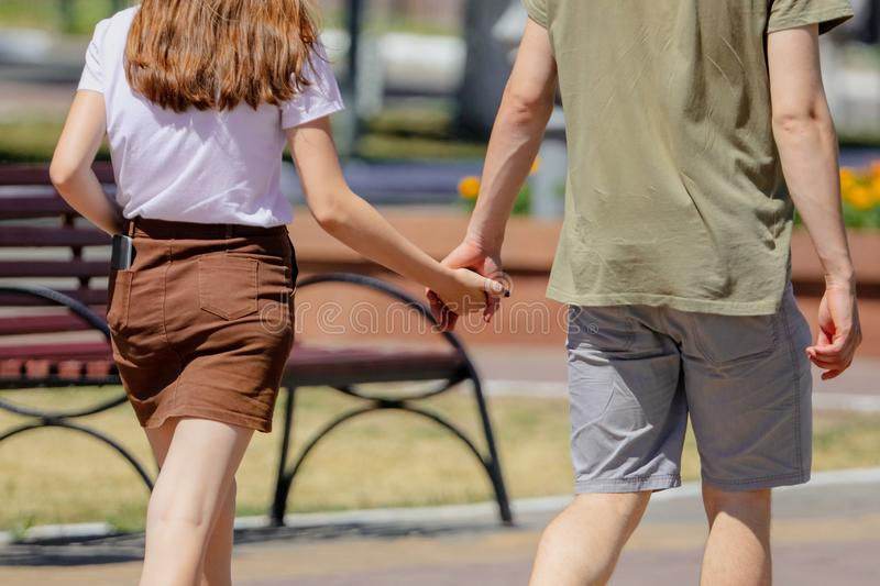 A guy with a girl holding hands royalty free stock photo