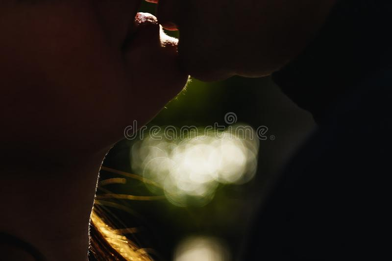 Guy and girl kiss large lips lips silhouettes. The guy is kissing the girl stock photos