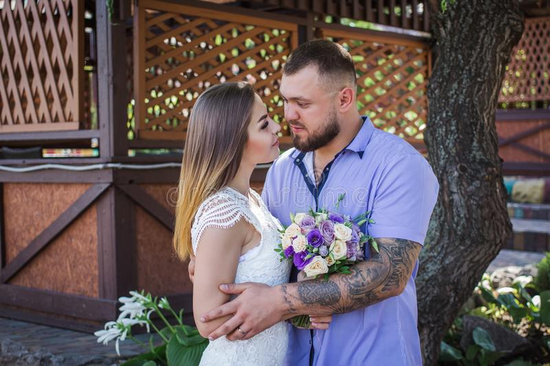 Guy and girl look at each other, portrait of a romantic couple,man and woman kissing in a dramatic light, girl holding flowers in. Guy and girl look at each royalty free stock photos