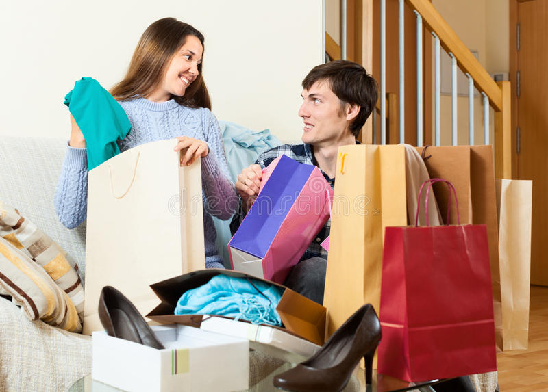 Guy and girl looking their purchases stock photo