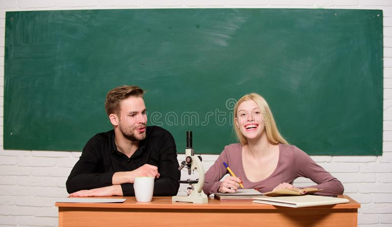 Guy and girl sit classroom. Studying in college or university. Friends students studying university. College fun. Modern stock image