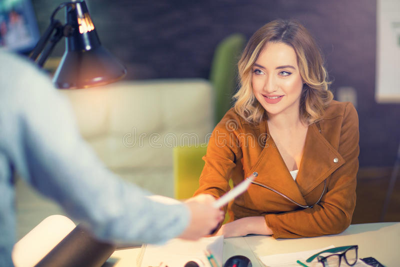 Guy giving a curriculum vitae to his interviewer. In a job interview royalty free stock photography