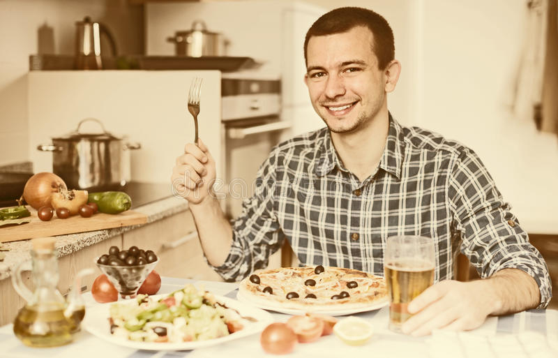 Guy going to eat pizza. Single guy going to eat pizza stock photography