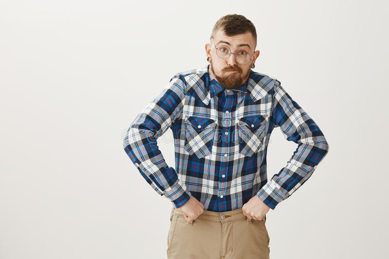 Guy got old too quickly. Funny talented male actor in glasses and blue plaid shirt mimicking grandfather, making faces royalty free stock photography
