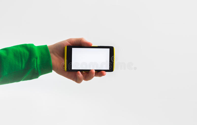 guy in green, greenery, t-shirt, sweatshirt, holding a smart phone in his hand on a white background your text, the presentation royalty free stock photos