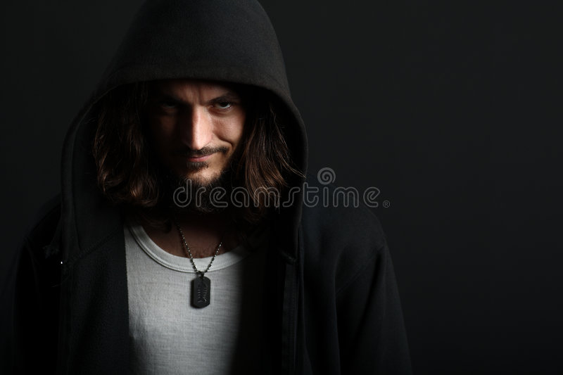 Download Guy Grinning In Hood With Dogtag Stock Photo - Image: 8186264