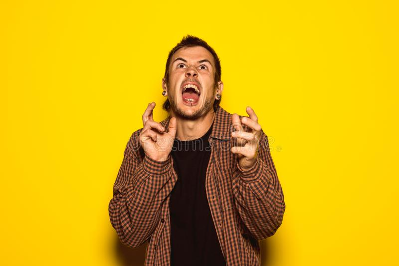Guy handsome with expression of madness. And furious stock photo