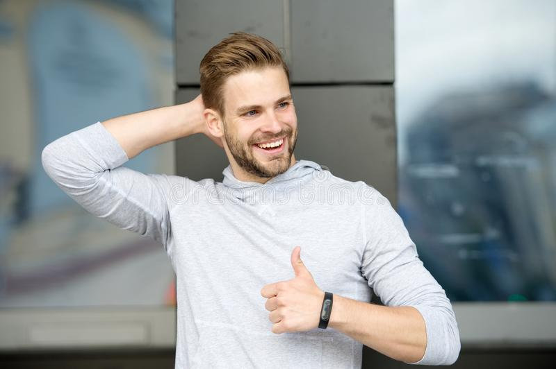 Guy happy emotional approve expression. Approve or recommend concept. Man with brilliant smile unshaven face shows thumb royalty free stock photo