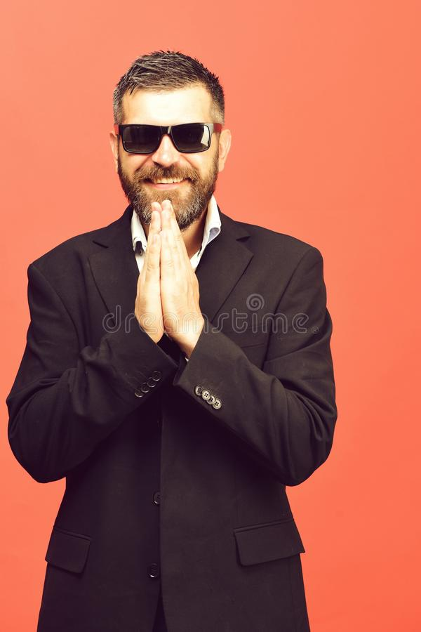 Guy with happy face and sunglasses isolated on salmon pink royalty free stock image