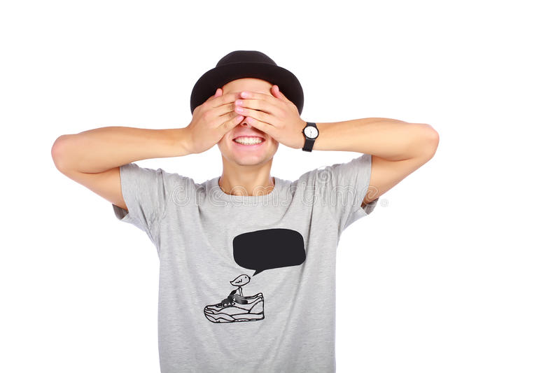 Guy in a hat with closed eyes. On white background stock photos