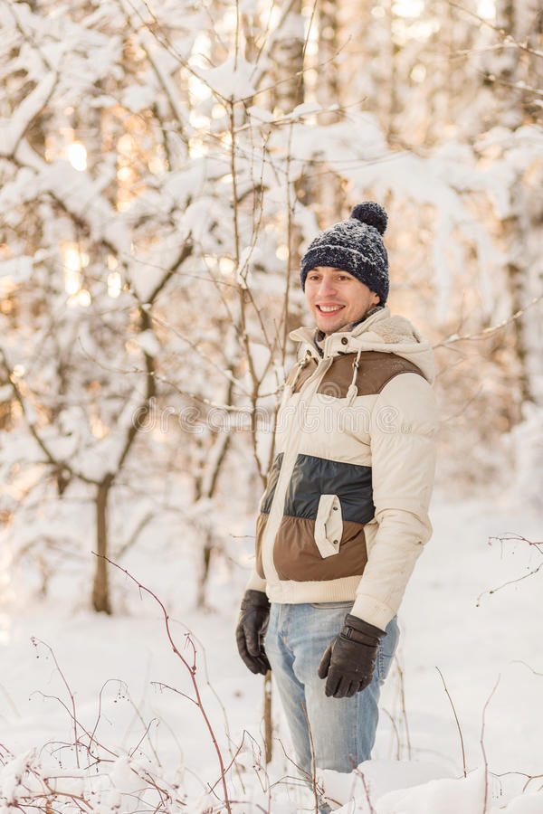 Download The Guy Have A Rest In The Winter Woods. Stock Photo - Image: 83720375