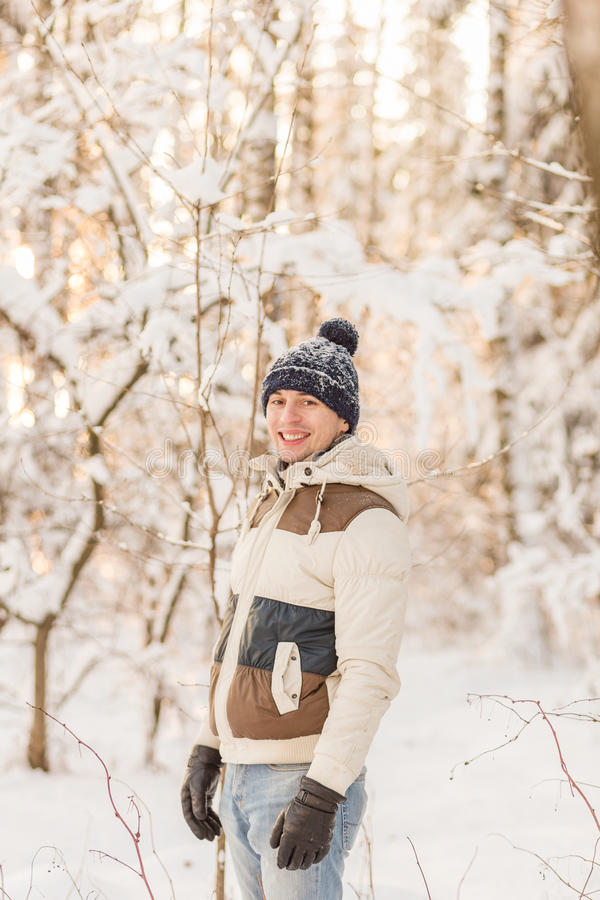 Download The Guy Have A Rest In The Winter Woods. Stock Image - Image: 83720469