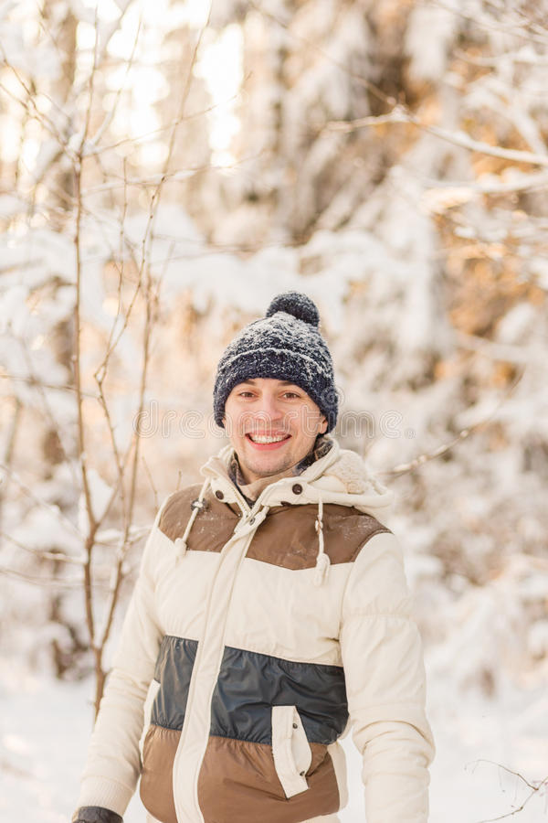 Download The Guy Have A Rest In The Winter Woods. Stock Photo - Image: 83721444