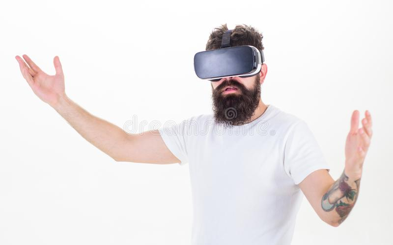 Guy with head mounted display interact virtual reality. Hipster exploring virtual reality. Virtual presentation. Man. Bearded hipster VR glasses white royalty free stock photo
