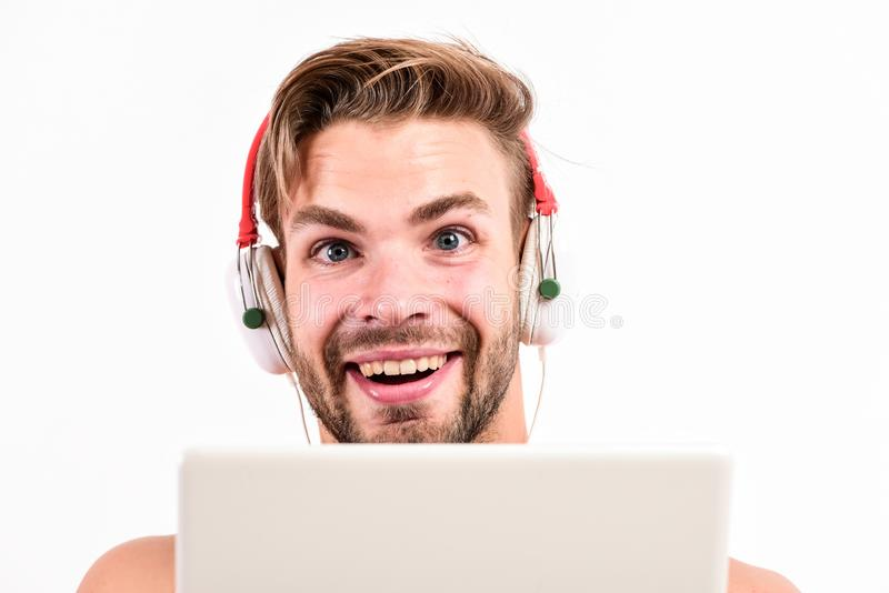Guy with headphones and laptop. Student life. Online entertainment. Education opportunities. Gadget making life much. Easier. Leisure and fun. Portable gadget royalty free stock images