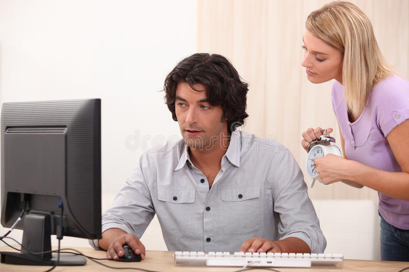 Guy in his office. Teaching women IT stock photo