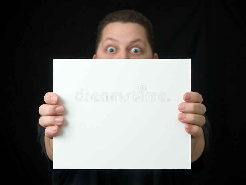Download Guy Holding Blank Sign Or Paper On Black Stock Photo - Image: 7731178