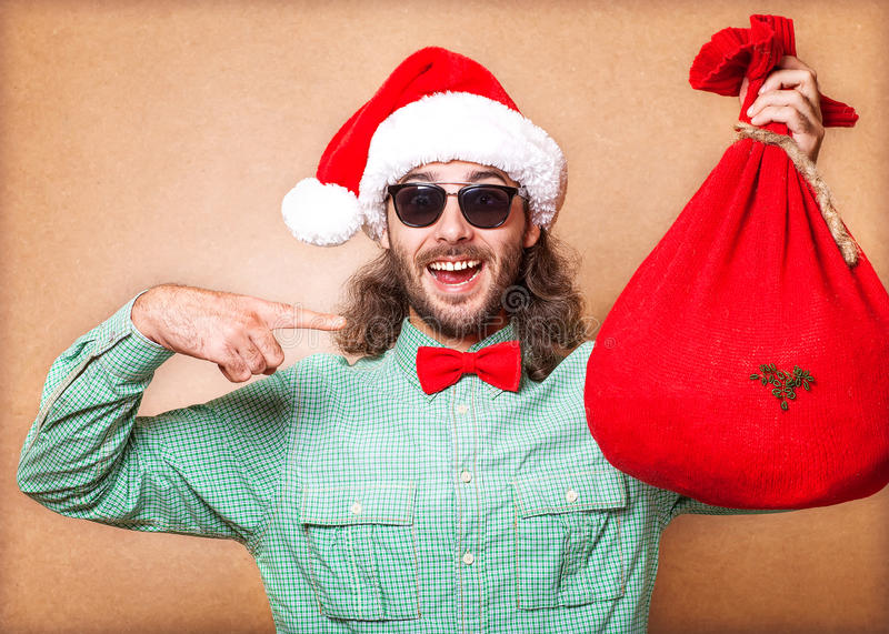 Guy holding a gift. And emotionally happy Christmas royalty free stock photos