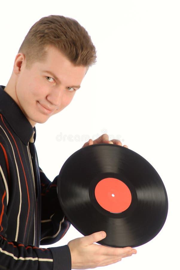 Guy holds in hands vinyl disk stock images