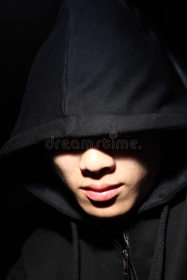 Guy in a hood. Monochrome picture of a guy in a hood royalty free stock image