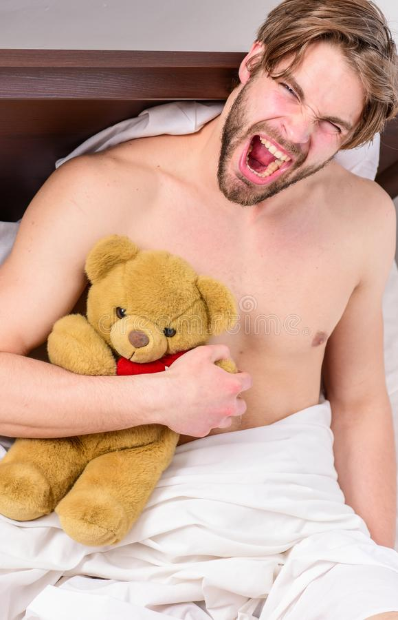Guy hug teddy bear soft plush toy. Man unshaven bearded face relax with favorite teddy bear. Sweet memories from. Childhood. Sweet dreams concept. Man handsome stock images