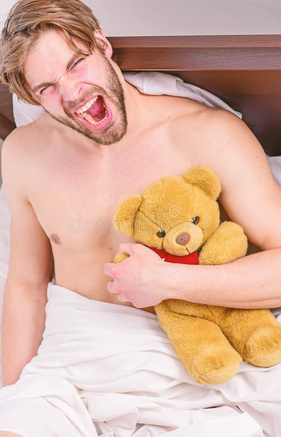 Guy hug teddy bear soft plush toy. Man unshaven bearded face relax with favorite teddy bear. Sweet memories from. Childhood. Sweet dreams concept. Man handsome royalty free stock photos