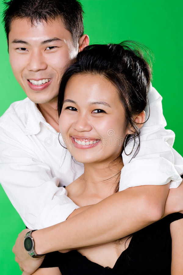 Guy hugging from behind of his girl royalty free stock image