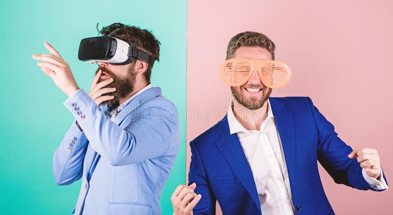 Guy interact in virtual reality. Hipster exploring virtual reality. Business implement modern technology. Real fun and. Virtual alternative. Man with beard in royalty free stock photography