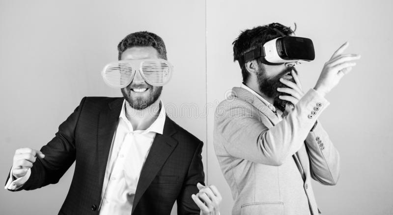 Guy interact in virtual reality. Hipster exploring virtual reality. Business implement modern technology. Real fun and. Virtual alternative. Man with beard in stock photography