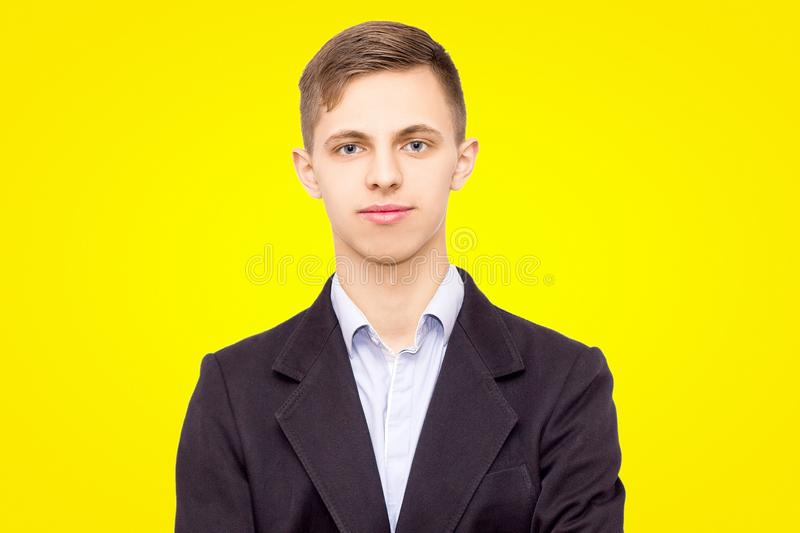 Guy in a jacket and shirt, isolated on yellow background, quiet young man royalty free stock images