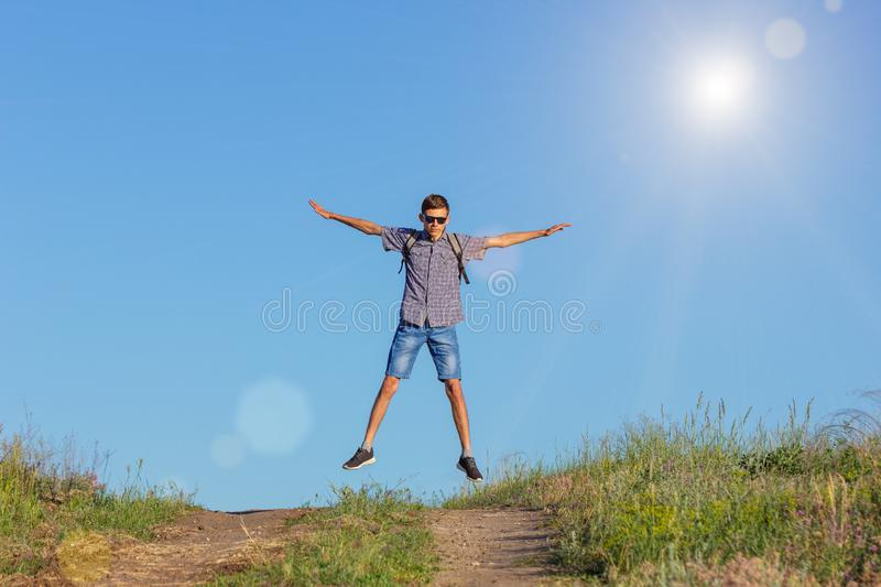 Guy jumping to the top on the road, travel concept royalty free stock photo