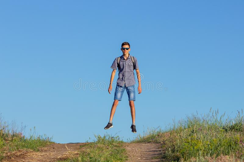 Guy jumping to the top on the road, travel concept stock photos