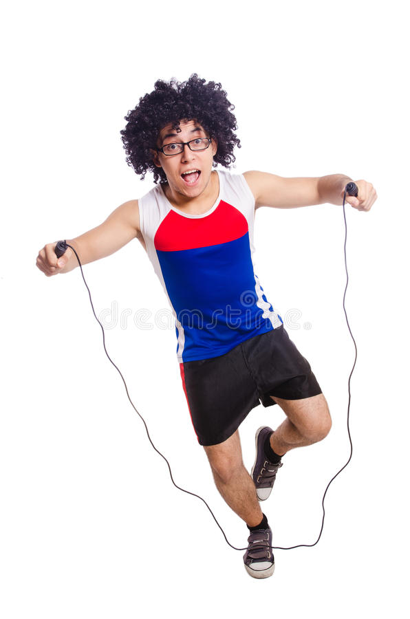 Guy jumps with skipping rope isolated on white. Guy jumps with skipping rope on white stock photo