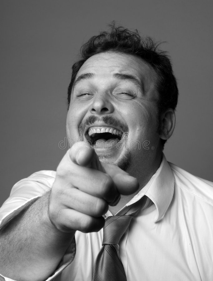 Guy laughing at you. Man pointing his finger and laughing at you